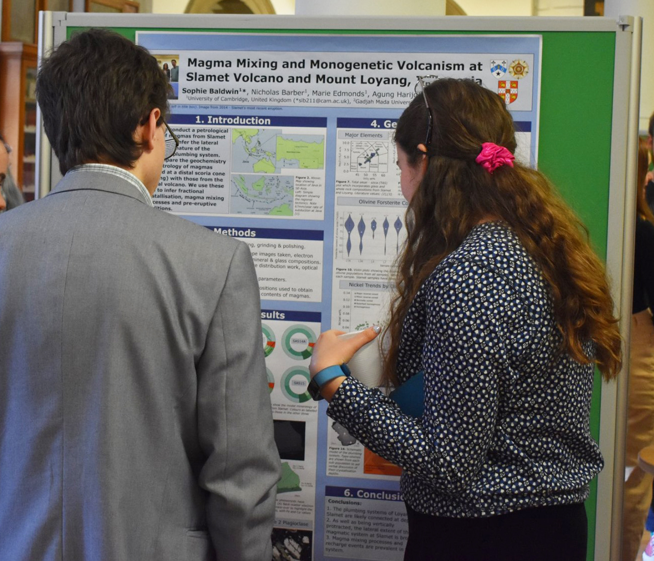 First prize winner Sophie Baldwin discusses her poster with third year students